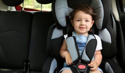 Boy,sitting,in,a,car,in,safety,chair