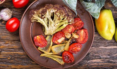 Roasted,vegetables,with,herbs,on,a,clay,plate,,ducane,diet